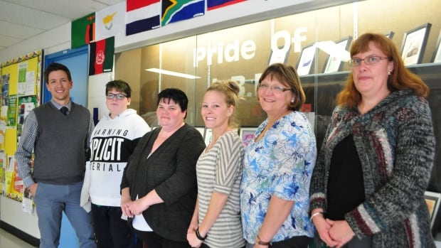 (Left to right) Resource room teacher Jeremy Ramsden, Grade 8 student Kyle Janson, Carla Janson, educational assistant Courtney Sjodin, Grade 2 teacher Diana Munkholm, and Principal Janet Simpson.