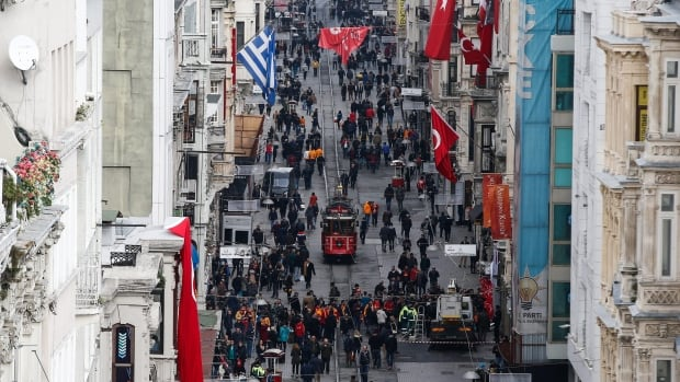 Pedestrians fill Istiklal Street in Istanbul on Mar. 20, 2016, a day after a suicide attack carried out by a Turkish citizen with ties to ISIS killed four other people.