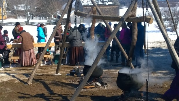 Cauldrons of maple sap boil as Syrian refugees watch. The fresh syrup proved popular over the weekend both as a treat in the snow.