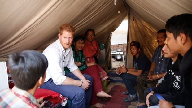 Prince Harry visits a temporary shelter at a camp for displaced families in Bhaktapur, Nepal, on Sunday.