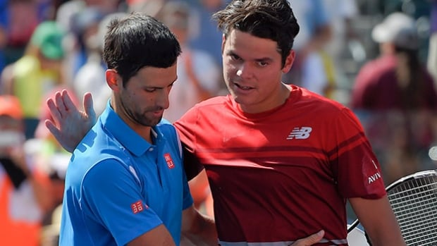 Novak Djokovic, left, greets Milos Raonic after their finals match at the BNP Paribas Open tennis tournament on Sunday in Indian Wells, Calif.