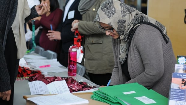 Participants register for a forum on mental illness and addiction in the Canadian Muslim community, which was held at Simon Fraser University's Surrey campus on March 19.