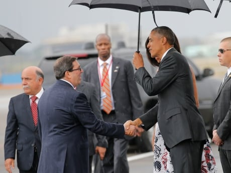 U.S. President Barack Obama shakes hands with Cuban Foreign Minister Bruno Rodriguez as Obama and his family arrived Sunday at Havana's international airport for a three-day trip.