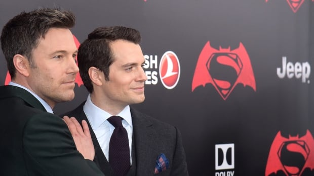 Ben Affleck, left, and Henry Cavill attend the premiere of Batman v Superman: Dawn of Justice at New York's Radio City Music Hall on Sunday.