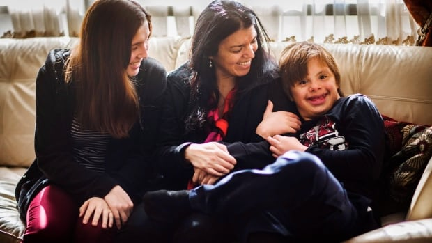 Nico Montoya, a 13-year-old boy with Down syndrome, with his mother Alejandra Garcia, centre, and his sister Tania at their home in Richmond Hill, Ont. The family was denied permanent Canadian residency arguing Down Syndrome would be a burden on taxpayers.