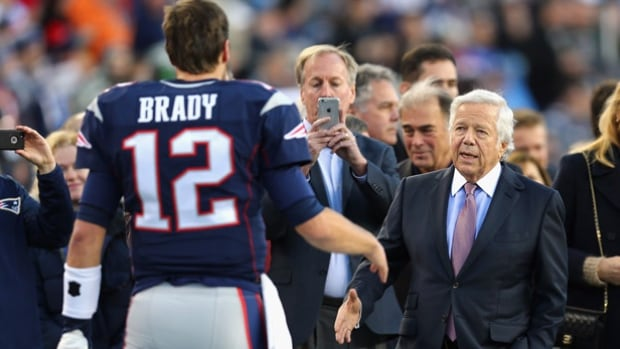 New England Patriots owner Robert Kraft, right, meeting quarterback Tom Brady, has asked the NFL for the return of two draft picks forfeited in the 'Deflategate' scandal.