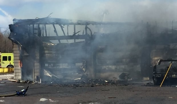 The remains of a bus garage that burned near a Hants County school