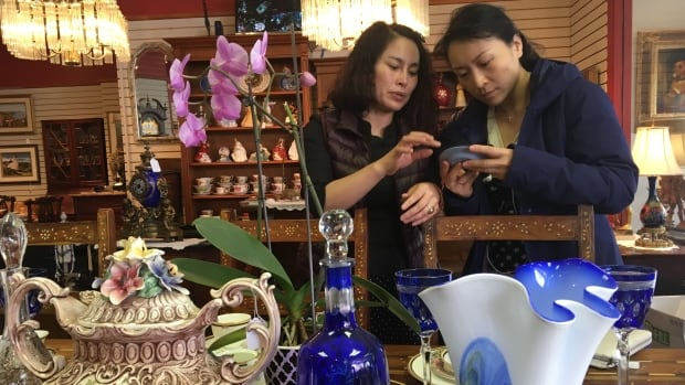 Jing Zhang (left) arrived in Canada in 2014 and PEI Connectors helped her set up her Charlottetown antique business.