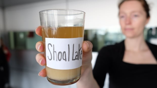 Jacquie Nicholson, a member of Friends of Shoal Lake 40, offered up a sample of polluted water to people as they passed through a downtown Winnipeg skywalk.