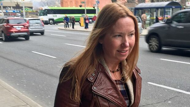 Toronto real estate agent Lisa Whidden, who had a romantic relationship with accused killer Dellen Millard before his arrest, leaves the John Sopinka Courthouse in Hamilton.