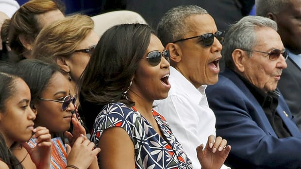 Bonding over baseball. The Obamas take in an exhibition game with Cuban President Raul Castro between the Cuban National team and the Tampa Bay Rays on Tuesday in Havana.