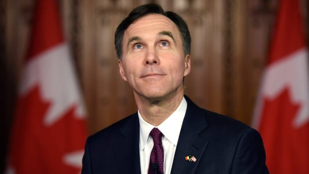 Finance Minister Bill Morneau looks up in the foyer of Parliament as he participates in interviews after tabling the federal budget. The Liberals will have to prove their deficit-financed investments can be effective in growing the economy.