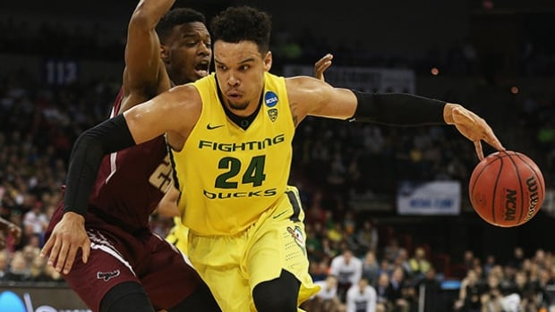 Oregon's top scorer, Dillon Brooks scored 25 to lead the No. 1-seeded Ducks past Saint Joseph's in the second round.