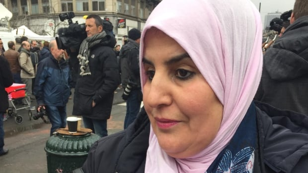 A Moroccan-Belgian woman who lit a candle Wednesday and left it at Place de la Bourse in central Brussels in memory of the bombing victims says she 'can't understand why people would kill innocents.'