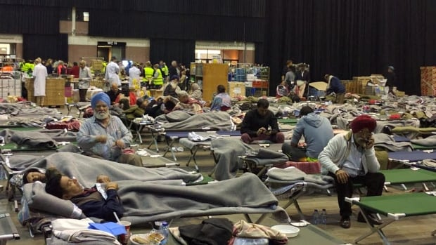 Hundreds of people who fled the Brussels airport after extremists attacks stayed the night on army-style cots in a sports arena.