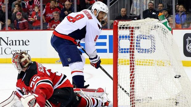 """Capitals winger Alex Ovechkin, seen here beating Devils goalie Cory Schneider with the shootout winner on Feb. 6, led the NHL's goal-scoring race with 43, four more than Chicago's Patrick Kane, entering play Wednesday. Should he hold on, Ovie would win his fourth straight Maurice """"Rocket"""" Richard Trophy as the league's scoring champion and sixth overall."""