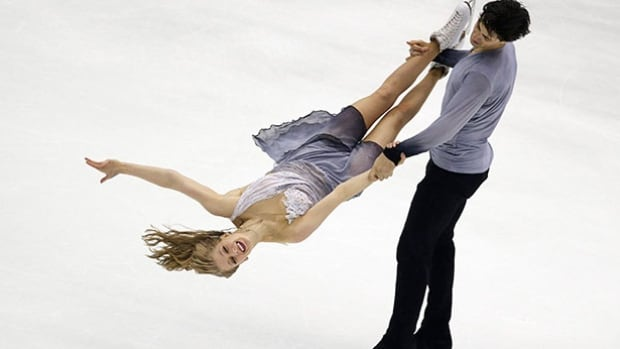 Kaitlyn Weaver and Andrew Poje from Canada perform in the Ice Dance Free Dance program at the Taiwan ISU Four Continents Figure Skating Championships in Taipei, Taiwan, in February. Weaver and Poje finished in third place. The pair will compete next week at the world championships in Boston.