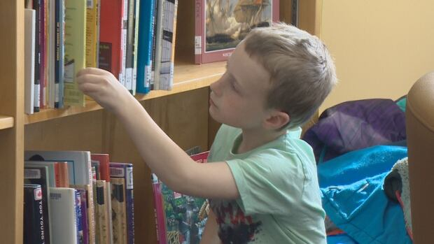 Some students from Bayview Elementary School attended the Saint John Free Public Library East Branch's grand opening at the Saint John Transit building on Wednesday.