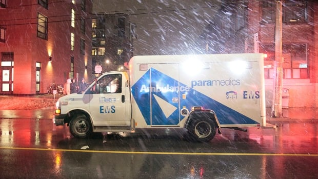 Rain falls at the scene of a shooting that left one man dead outside a mixed-use commercial and residential building in the Carlaw Avenue and Queen Street East area.