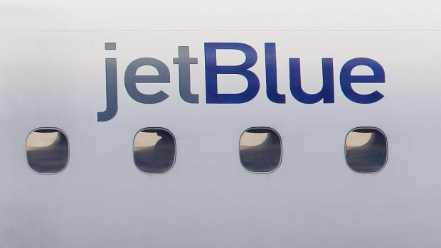 A JetBlue logo is displayed on the side of a jet as it taxis at Boston's Logan International Airport in a file photo.