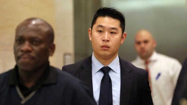 In a Tuesday, Feb. 9, 2016 file photo, Police officer Peter Liang, centre, exits the courtroom during a break in closing arguments in his trial on charges in the shooting death of Akai Gurley.