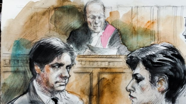 Justice William B. Horkins, centre, reads his decision in the trial of Jian Ghomeshi, at left, as Ghomeshi's lawyer, Marie Henein, at right, looks on.