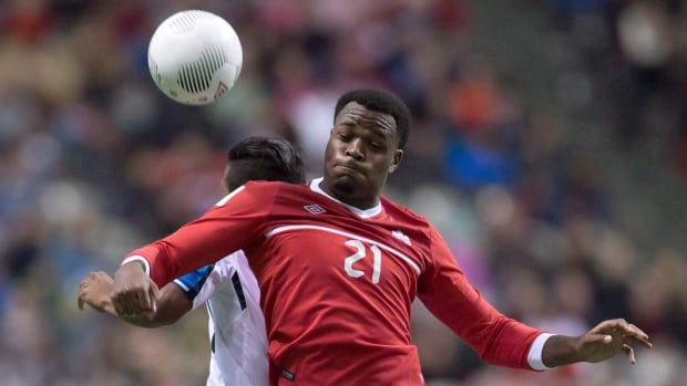 Cyle Larin battles for the ball at BC Place against Honduras last November.