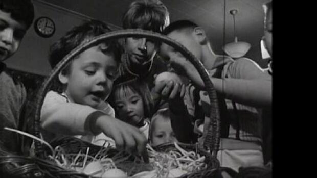 Children inspect Easter eggs in Ottawa in the 1960s.