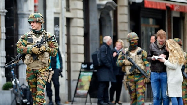 Belgian soldiers patrol along the Grand Place of Brussels following Tuesday's bombings. There is a palpable police and military presence in the city these days.