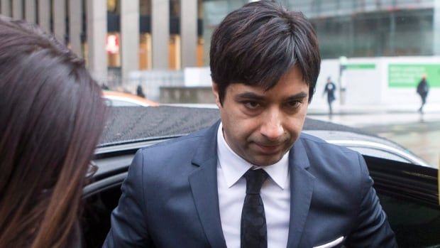 Jian Ghomeshi arrives at the Toronto courthouse for the verdict in his sexual assault trial, on Thursday.