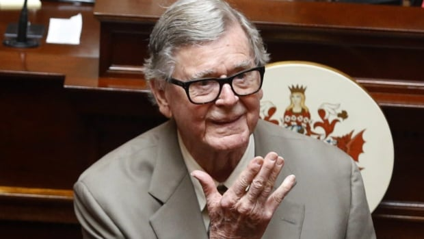 In this Wednesday, April 3, 2013 file photo, author Earl Hamner Jr. blows a kiss to relatives in the gallery as he is honored by the Virginia Senate at the state capitol in Richmond, Va.