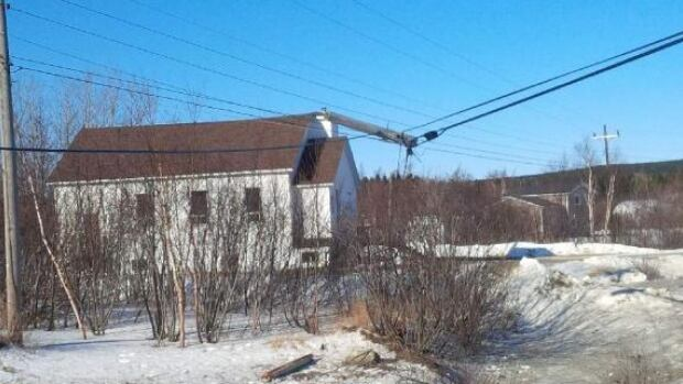 Lewisporte RCMP say a vehicle struck this utility pole before landing on the front lawn of a home near Loon Bay.