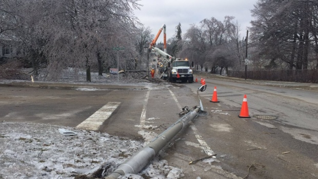 Hydro crews in Fergus deal with the aftermath of the ice storm on Friday.