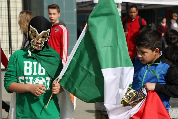 Mexico vs Canada FIFA Qualifying Match little guy with mask
