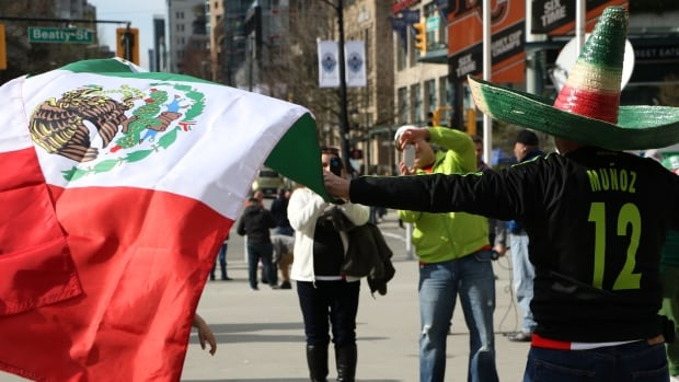 Mexican fans took pictures of each other and waived their home country's flag proudly.
