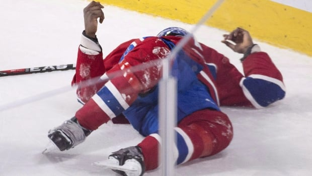Montreal Canadiens' P.K. Subban lies injured on the ice during third period NHL hockey action against the Buffalo Sabres in Montreal, Thursday, March 10, 2016. Subban practised with his teammates in a full contact jersey Wednesday for the first time since suffering a neck injury March 10 against the Buffalo Sabres. THE CANADIAN PRESS/Graham Hughes