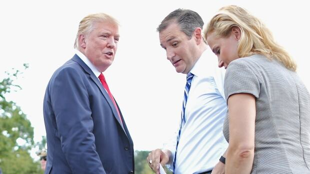 Republican presidential candidates Donald Trump, left, and Senator Ted Cruz, centre, and his wife Heidi Nelson Cruz meet on stage during a rally against the Iran nuclear deal on Sept. 9, 2015, in Washington, D.C. Trump recently posted unflattering pictures and comments of Cruz's wife on social media.