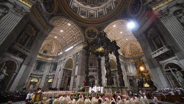 Pope Francis leads the Easter Vigil at St. Peter's Basilica in the Vatican. The vigil service included a papal baptism for 12 adults hailing from China, South Korea and other countries around the world.