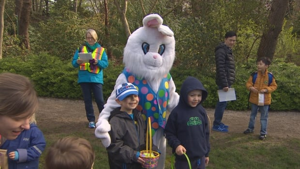 The Easter bunny poses with kids after the egg hunt at VanDusen Botanical Garden.