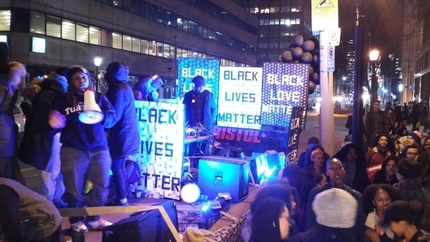 DJs and rappers perform at the Black Lives Matter protest in front of Toronto police headquarters on Saturday night. Demonstrators have been camped out on College Street after the Special Investigations Unit cleared a Toronto police officer of any wrongdoing in the shooting death of 45-year-old Andrew Loku from this past July.