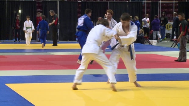 Athletes grapple during the competition.