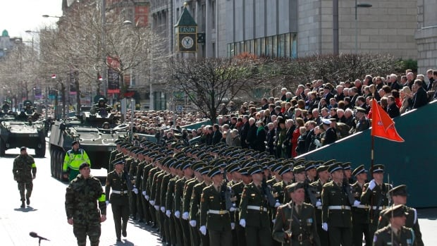 Sunday's five-hour parade marking the 100th anniversary of Ireland's Easter Rising included military ceremonies at key buildings seized by rebels in 1916.