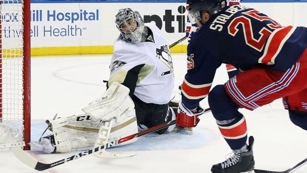 Penguins goalie Marc-Andre Fleury looks into the net but ended up making the save against Rangers forward Viktor Stalberg in a 5-3 victory on March 13 in New York. The Penguins also prevailed at Madison Square Garden in New York on Sunday night, with Sidney Crosby scoring the overtime winner to move Pittsburgh to within three points of the second-place Rangers in the Metropolitan Division with a game in hand. Finishing second means home ice in Round 1 of the playoffs.
