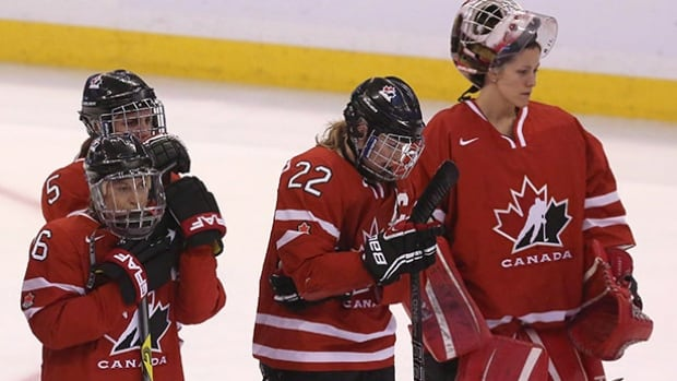 Team Canada's Rebecca Johnston (left), Lauriane Rougeau, Hayley Wickenheiser and Charline Labonte (right) show their disappointment after losing 3-2 to Team USA in the gold medal game at 2013 IIHF Womens World Ice Hockey championships. The Canadian women have lost five of the previous six world championship finals to the United States.