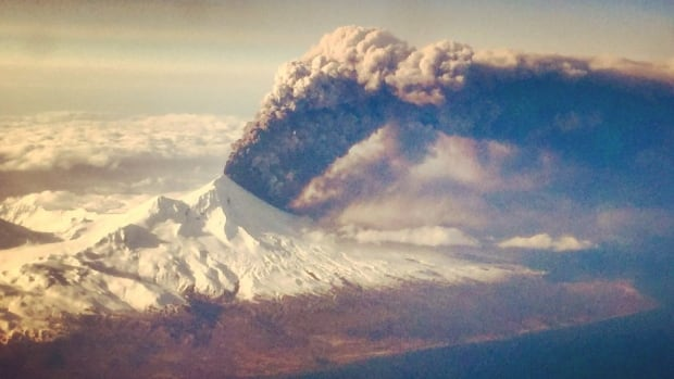 Pavlof volcano in eruption, March 27, 2016, shared by the Alaska Volcano Observatory. Photo taken from a flight travelling to Anchorage from Dutch Harbor.