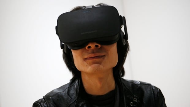 Peijun Guo wears the Oculus Rift VR headset at CES International in Las Vegas on Jan. 6. The consumer version of the Oculus Rift arrives for early adopters on March 28, kicking off a new wave of high fidelity virtual reality available for people's homes.