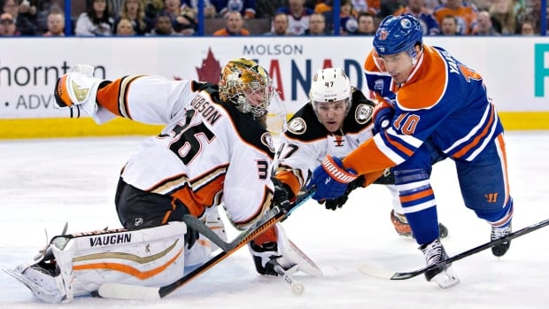 Ducks' goaltender John Gibson denies a scoring chance by the Oilers' Nail Yakopov in Edmonton. Yakupov later scored in the third period but Anaheim prevailed 2-1.