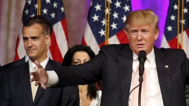 Republican U.S. presidential candidate Donald Trump's campaign manager, Corey Lewandowski, left, faces a battery charge in Florida.