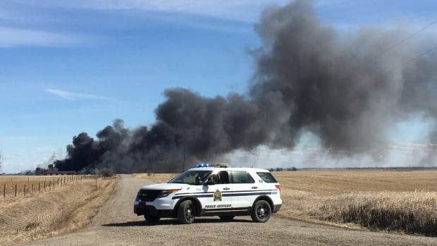 Black smoke emanates from the fire in Rocky View County.