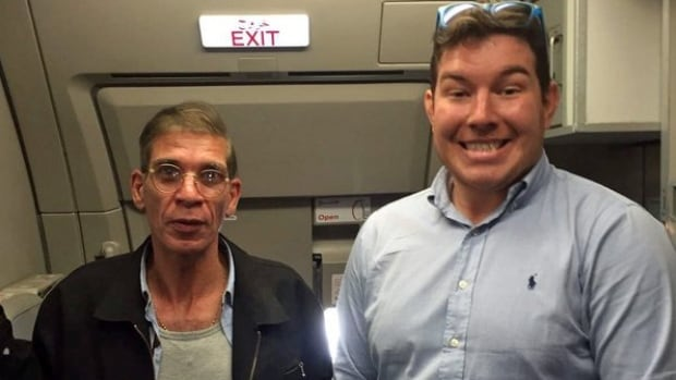 Ben Innes, right, poses with EgyptAir MS181 hijacker Seif Eldin Mustafa, whose fake bomb belt is just below the frame.